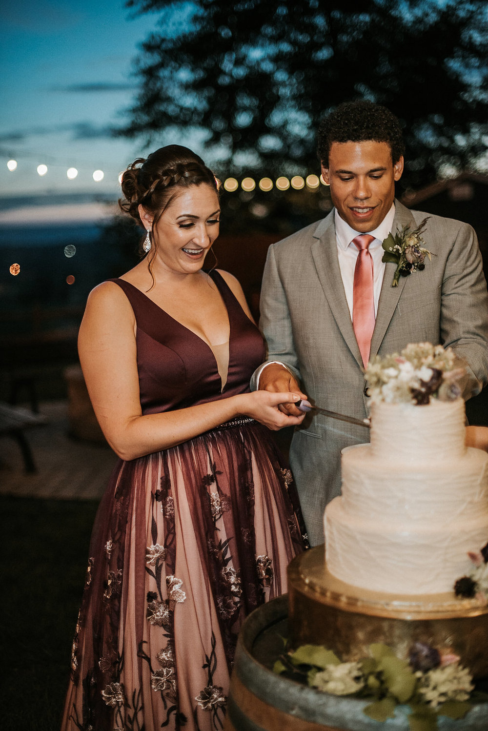bride and groom cutting cake at The Pavilion Shenandoah Woods