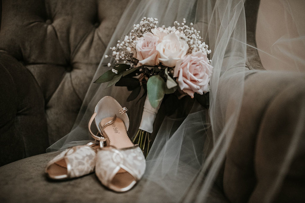 Wedding Detail Shot of Bride's Shoes and Bouquet at The Woodlands at Algonkian