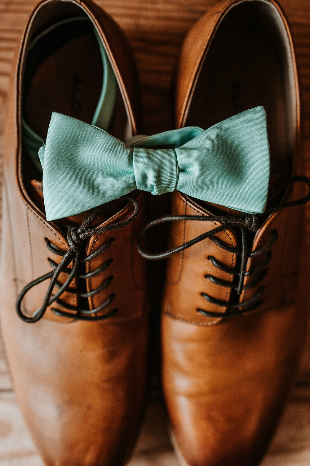 Wedding Detail Shot of Groom's Shoes and Bowtie at The Woodlands at Algonkian