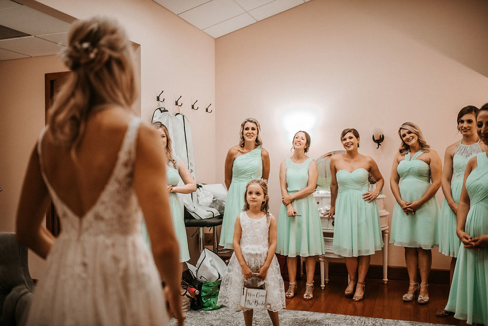 Bridesmaids seeing Bride in Wedding Dress at The Woodlands at Algonkian