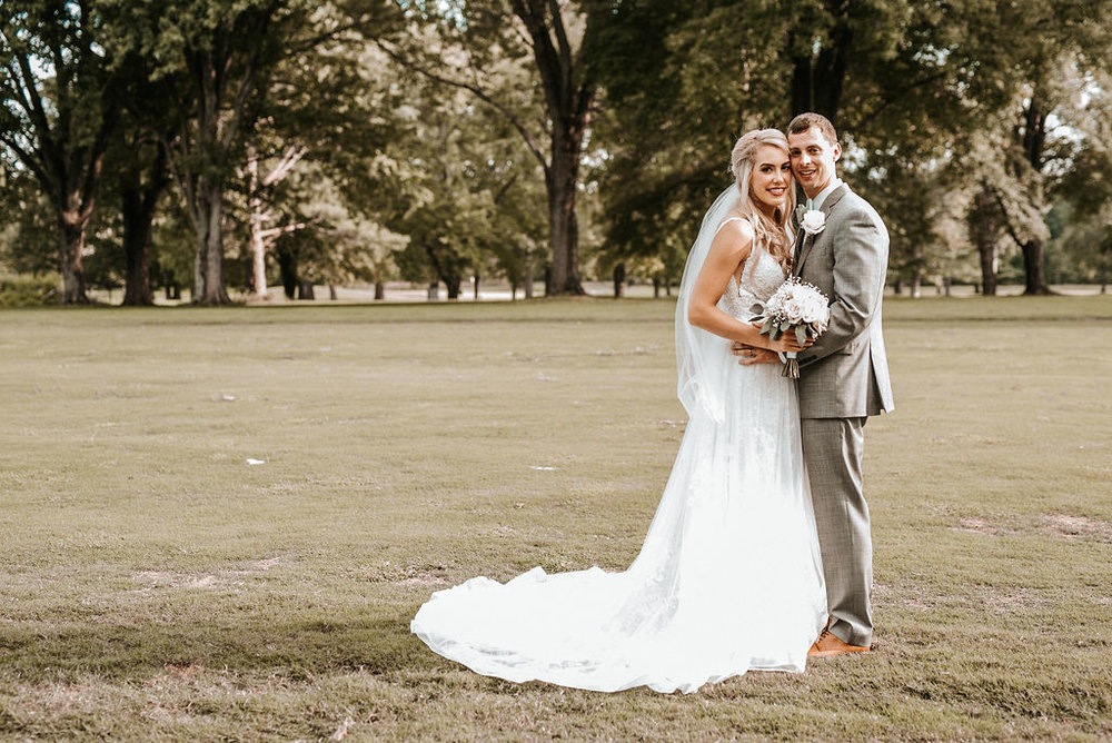 Bride and Groom Embracing at The Woodlands at Algonkian
