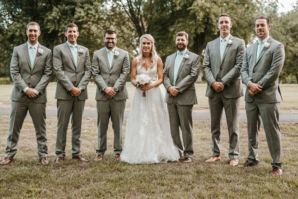 Bride Posing with Groomsmen at The Woodlands at Algonkian