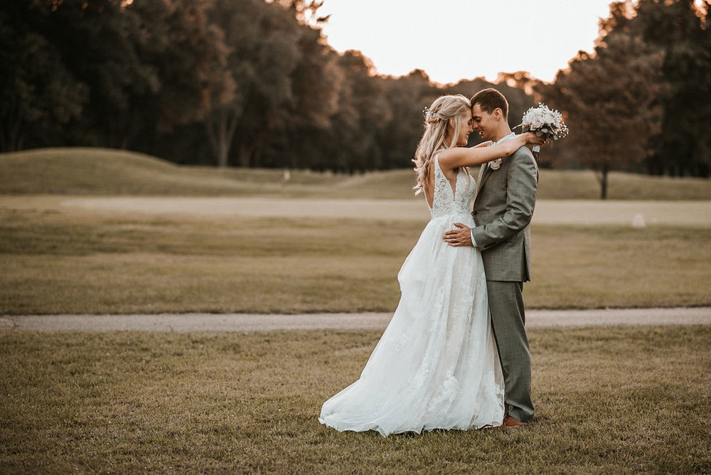 Bride and Groom Embracing at Sunset at The Woodlands at Algonkian
