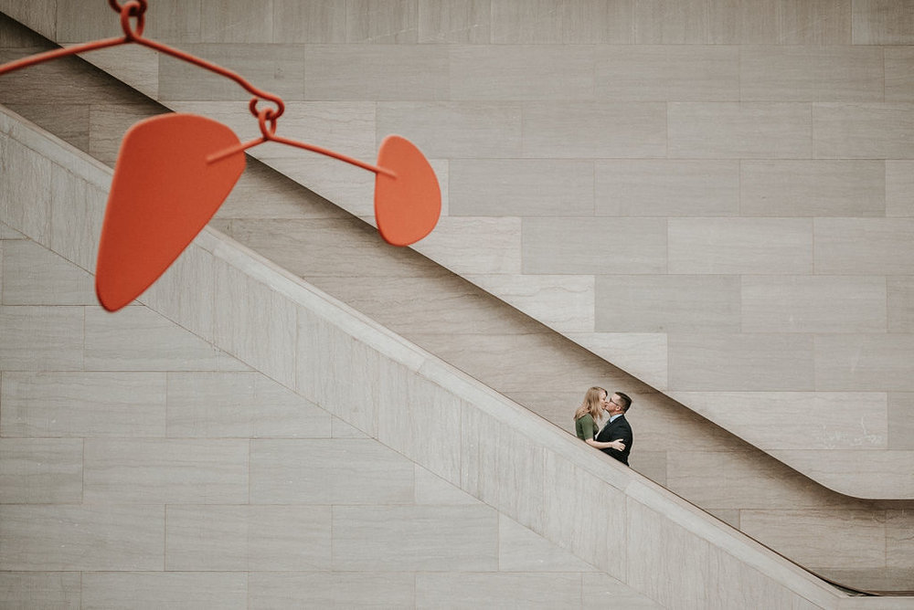 couple kissing during engagement session at Smithsonian National Portrait Gallery