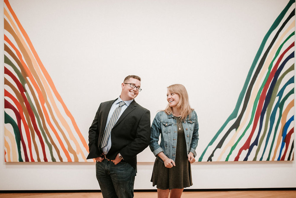 couple smiling during engagement session at Smithsonian National Portrait Gallery