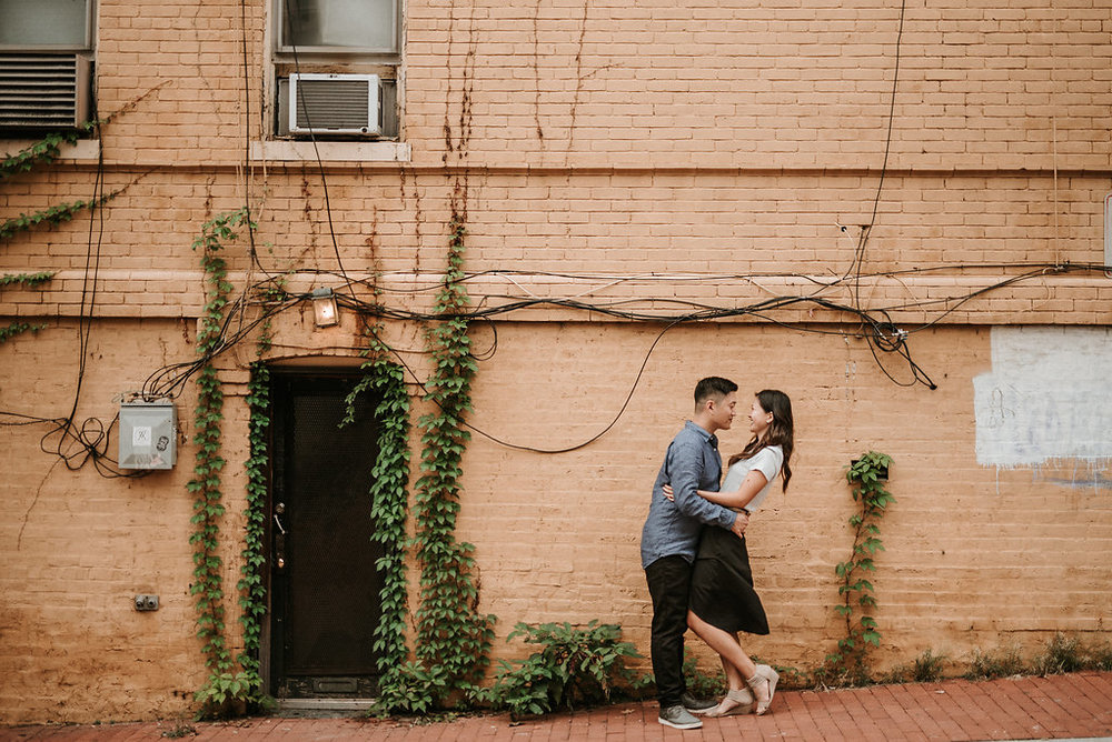 couple smiling during engagement session in Georgetown