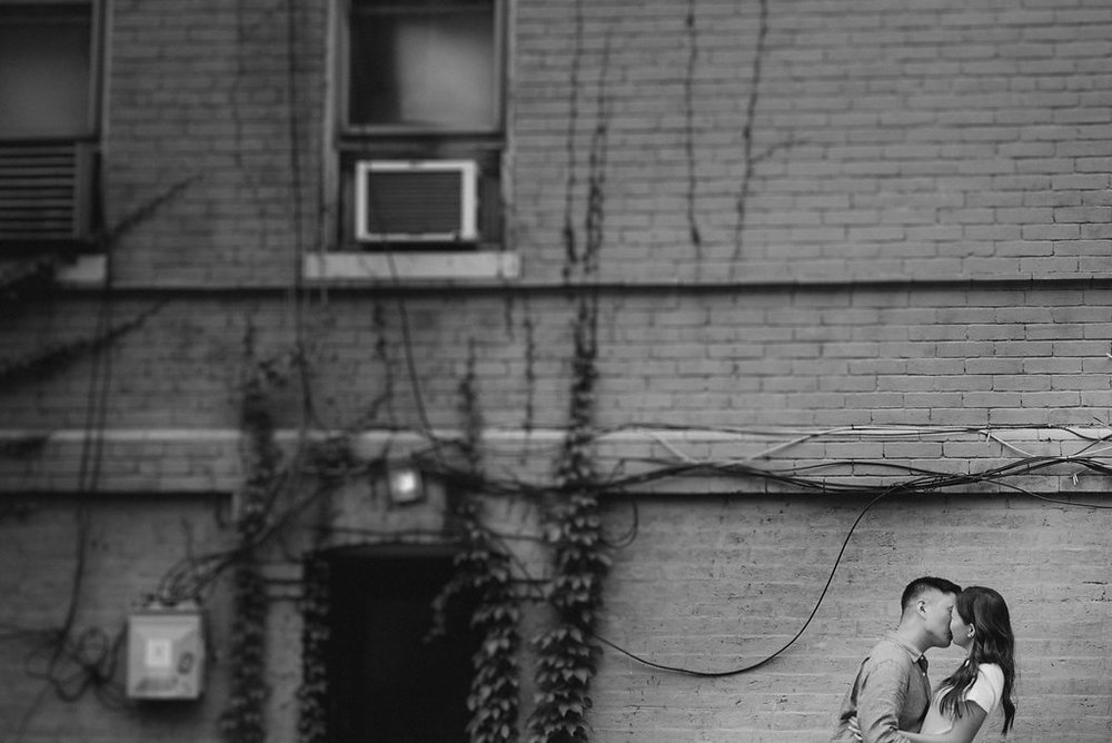couple kissing during engagement session in Georgetown