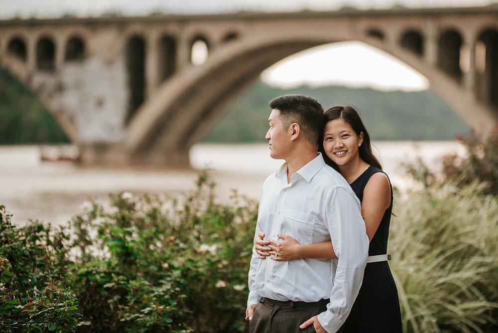 couple embracing during engagement session in Georgetown