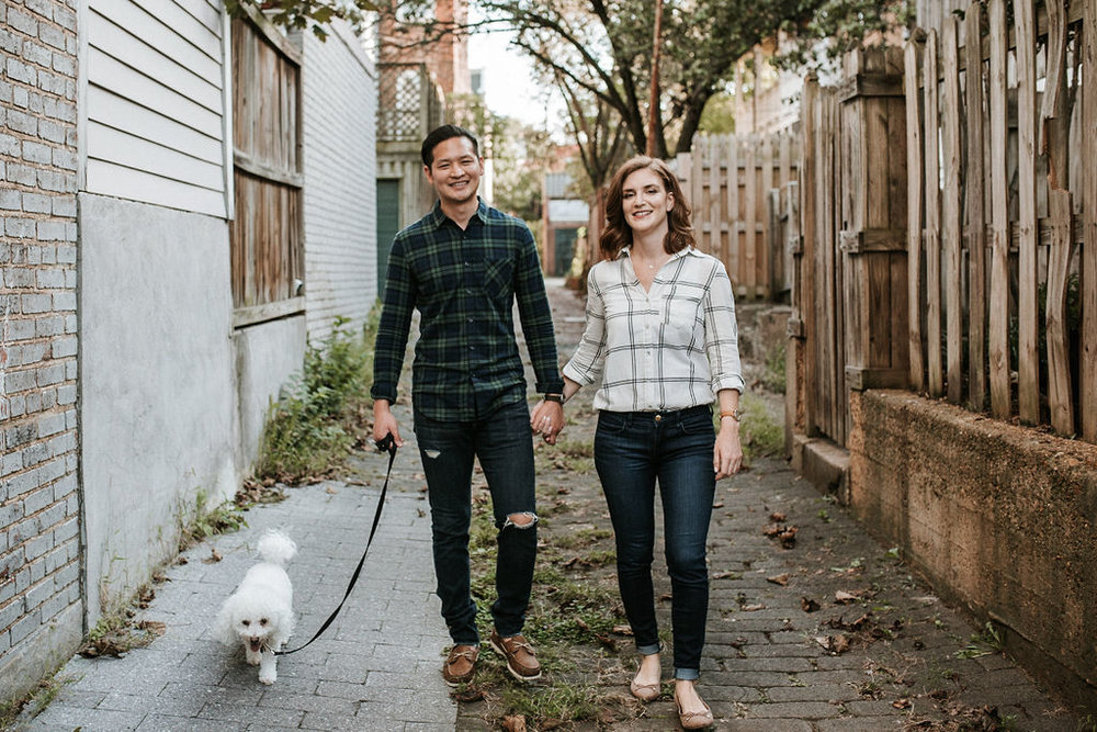 couple walking their dog during engagement session at H Street in Washington DC