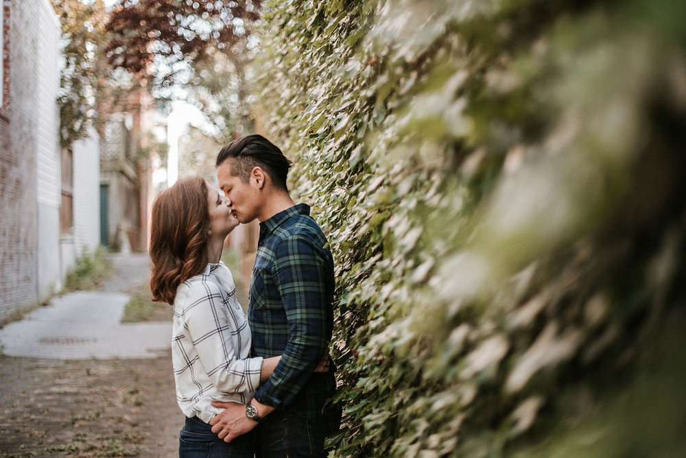 couple kissing during engagement session at H Street in Washington DC