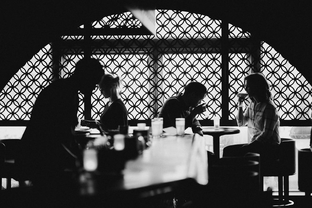couple having a drink at a bar during engagement session at H Street in Washington DC