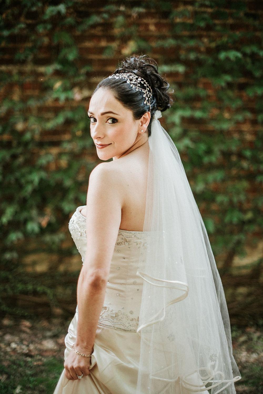Bride posing at Inn at the Old Silk Mill