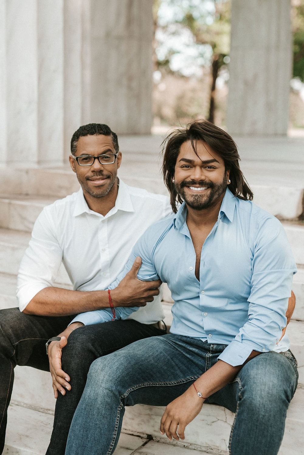 couple smiling during an engagement session at the National Portrait Gallery