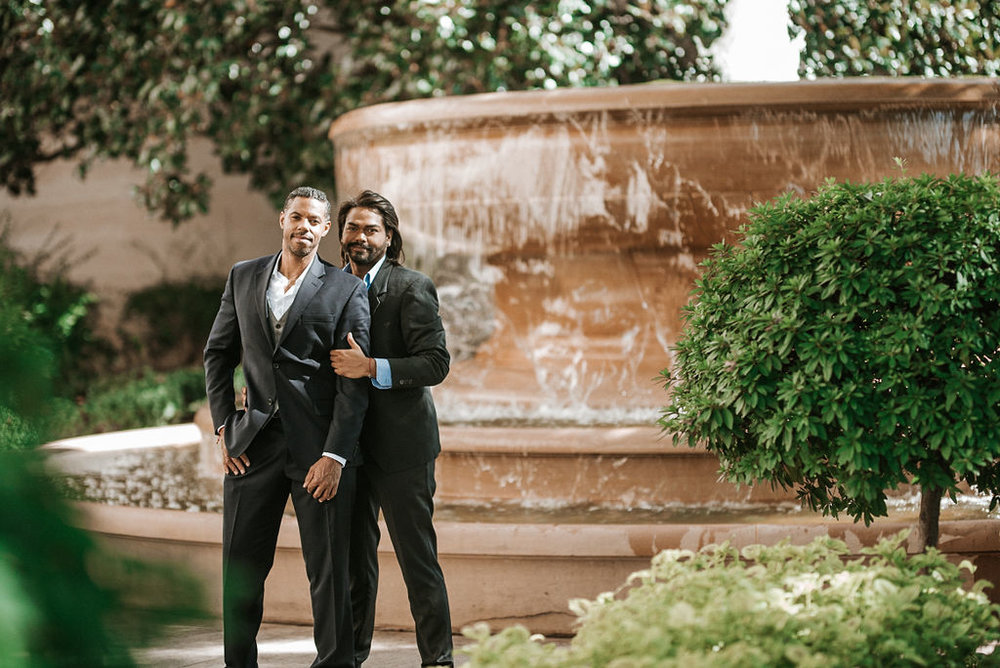 couple embracing during an engagement session at the National Portrait Gallery