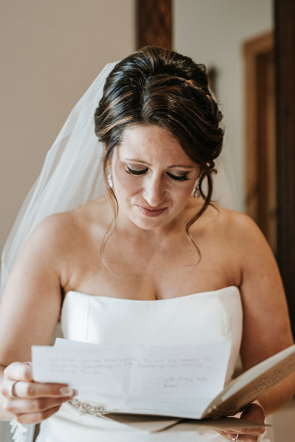 bride reading letter from groom at Linganore Winecellars