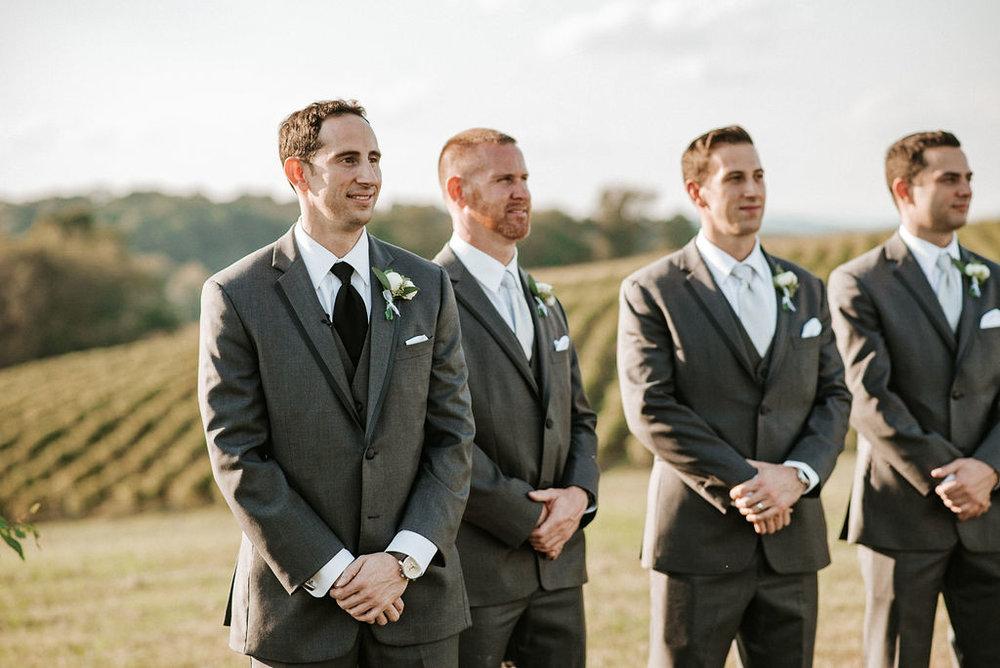 Groom seeing bride walk down the aisle at Linganore Winecellars