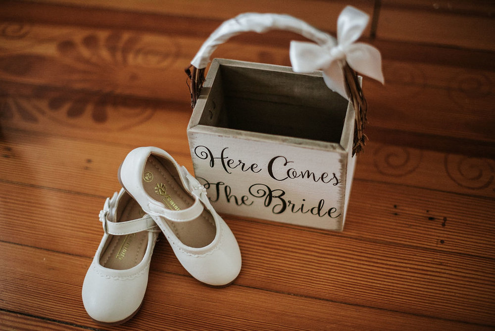 Detail Shot of flower girl's basket and shoes at Historic Rosemont Manor