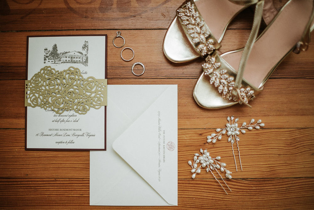 Detail Shot of Bride's shoes, rings, and stationary at Historic Rosemont Manor