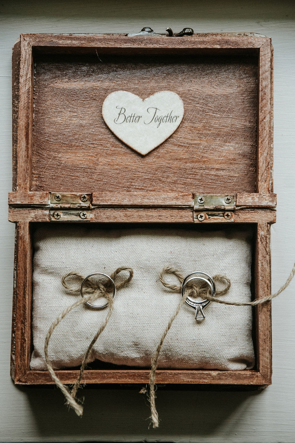 Wedding rings inside a wooden box at Historic Rosemont Manor