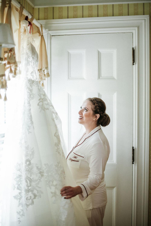 Bride admiring her wedding dress at Historic Rosemont Manor