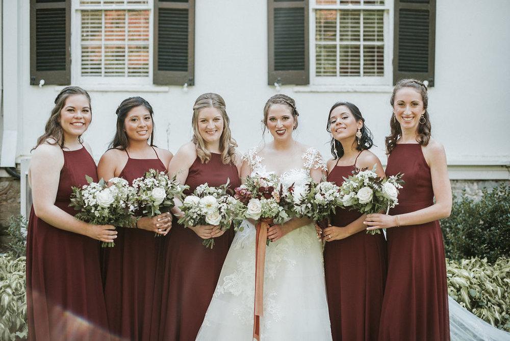 bride and bridesmaids smiling at Historic Rosemont Manor
