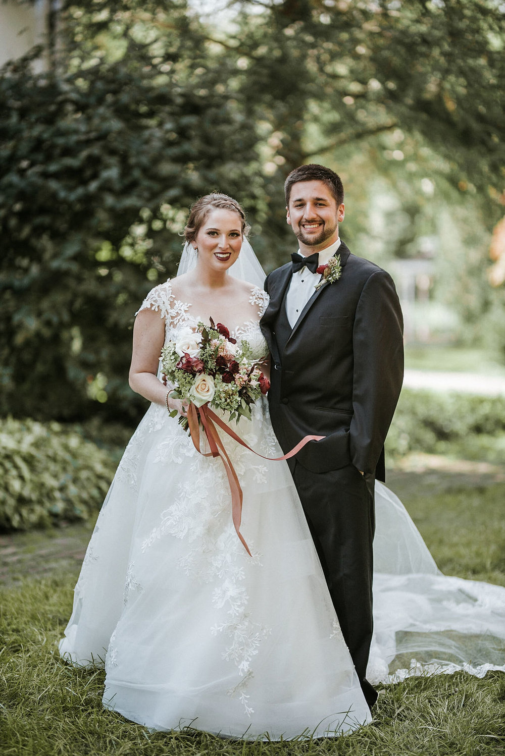 bride and groom smiling at Historic Rosemont Manor