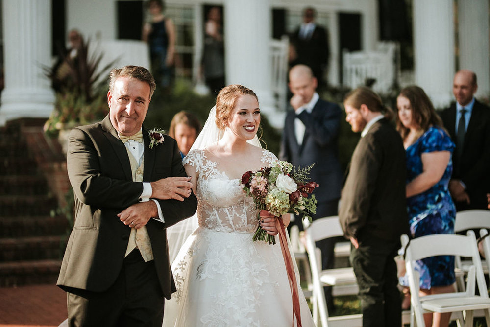 father of the bride walking bride down the aisle at Historic Rosemont Manor