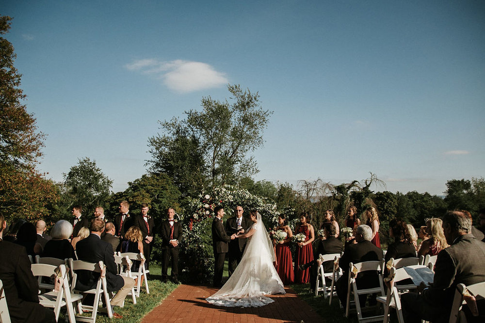 bride and groom holding hands at the alter at Historic Rosemont Manor