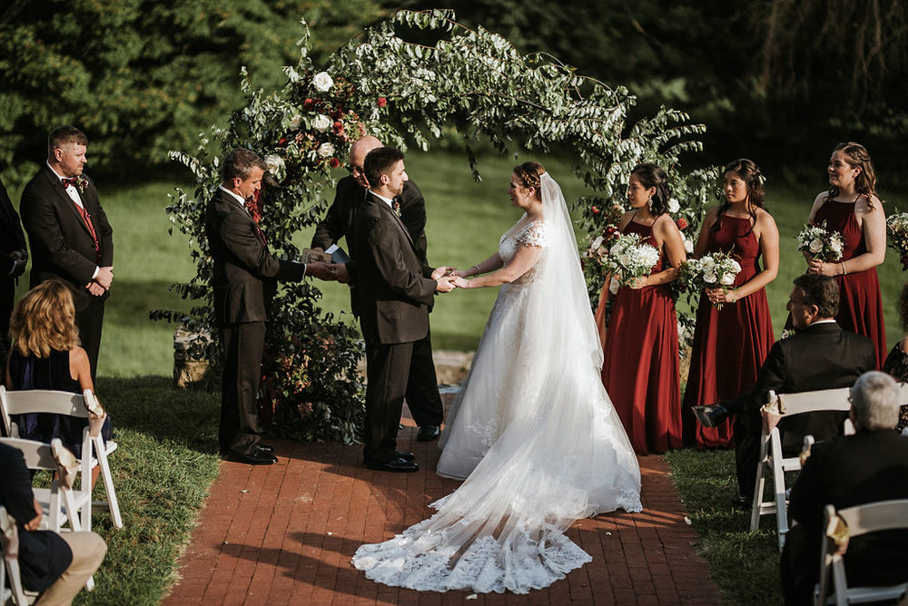 bride and groom exchanging vows at the alter at Historic Rosemont Manor