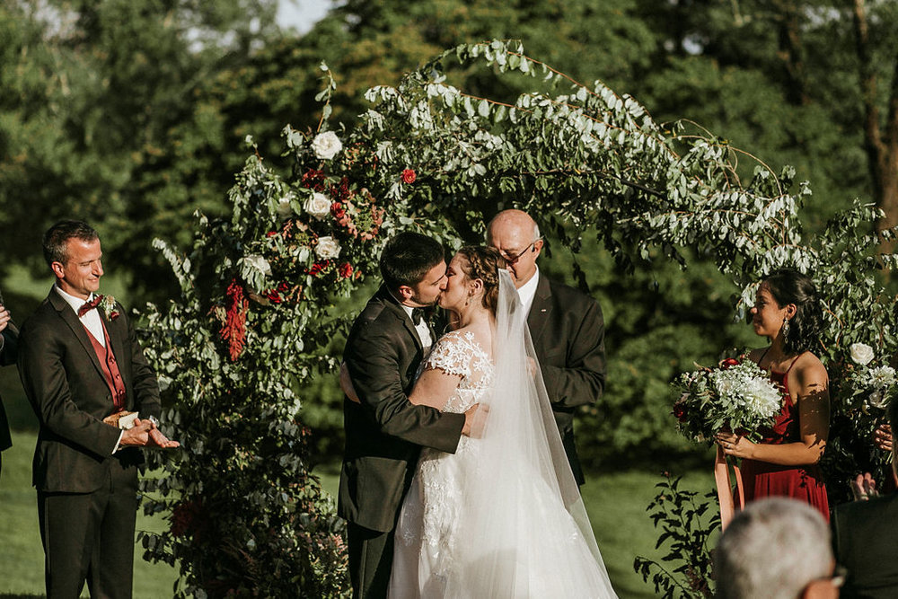 bride and groom kissing at the alter at Historic Rosemont Manor