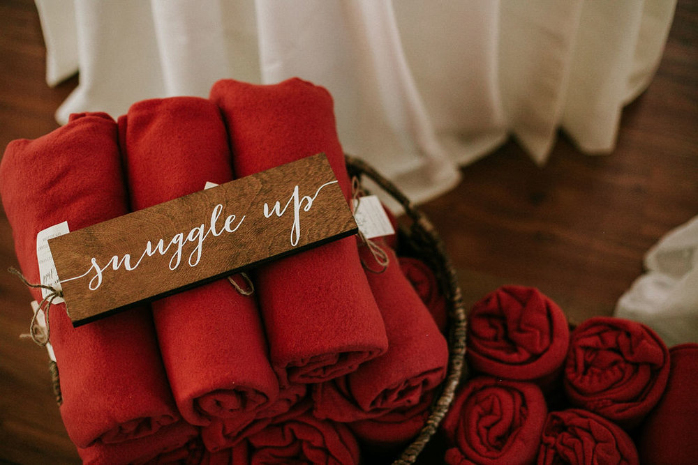 detail shot of blankets and a snuggle up sign at Historic Rosemont Manor