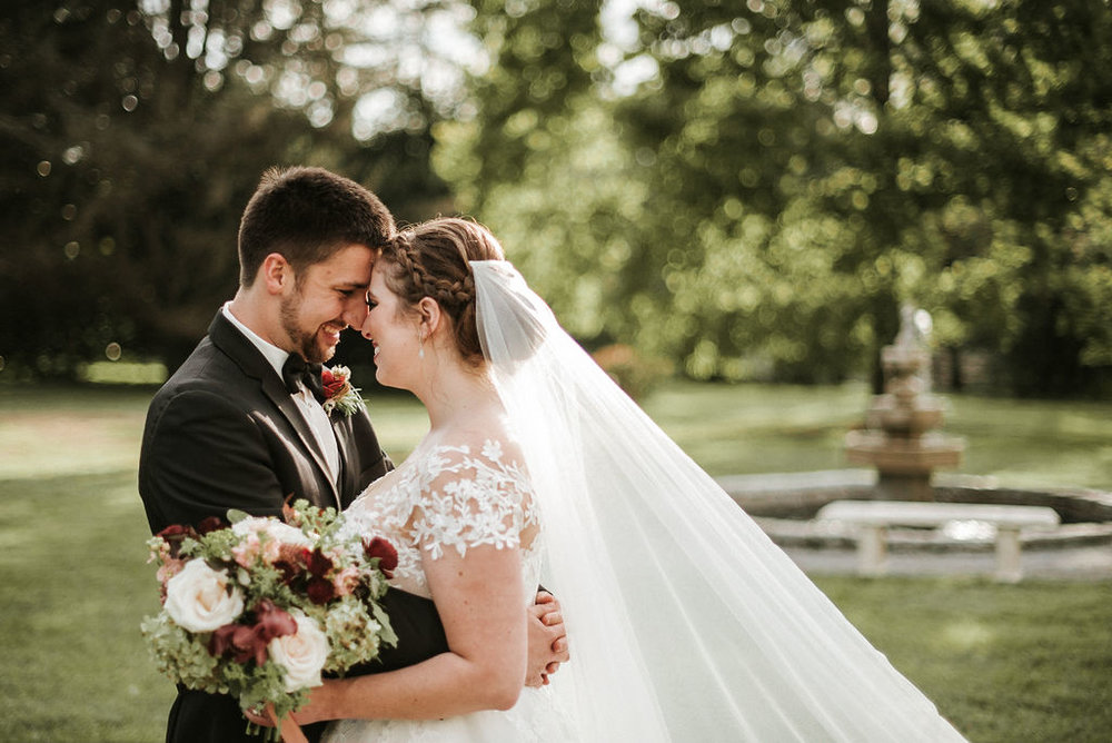 bride and groom smiling and embracing at Historic Rosemont Manor