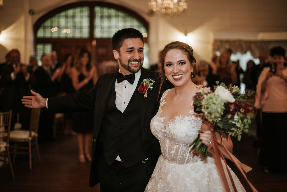 bride and groom smiling at reception at Historic Rosemont Manor