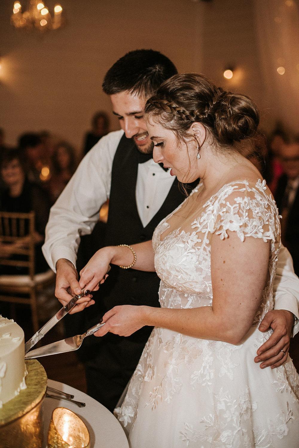bride and groom cutting the cake at Historic Rosemont Manor