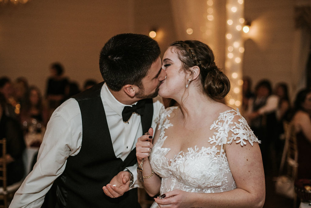 bride and groom kissing at reception at Historic Rosemont Manor