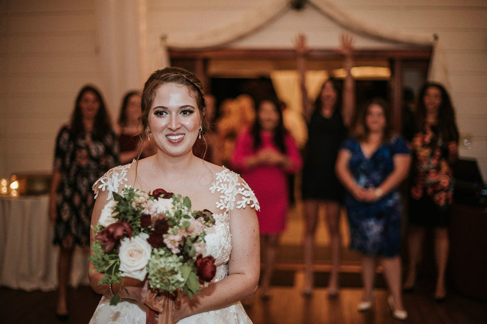 bride about to throw her bouquet at Historic Rosemont Manor