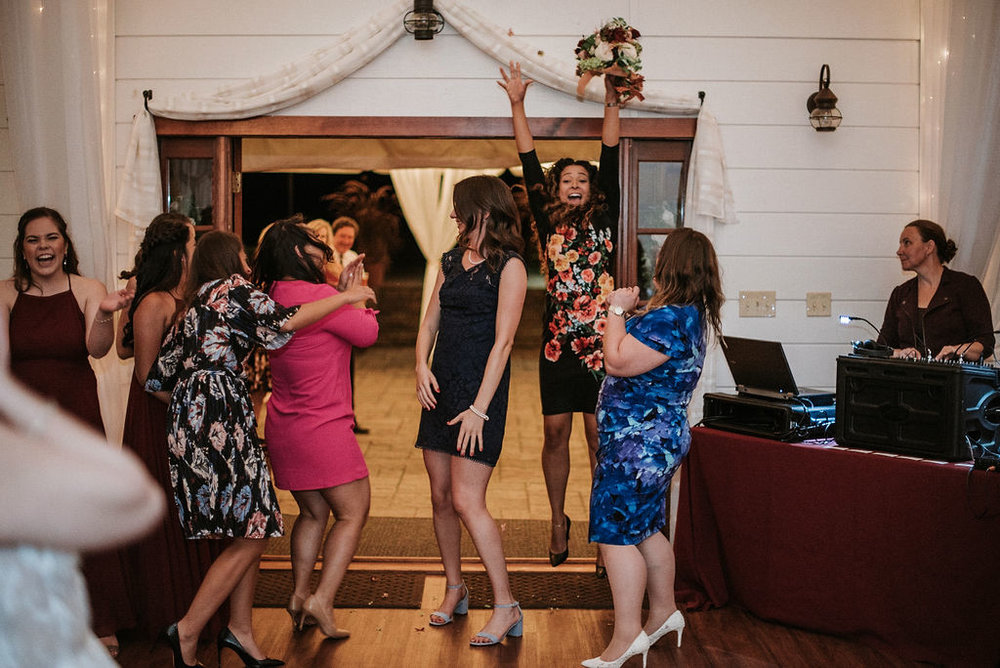 wedding guest catching the bouquet at Historic Rosemont Manor