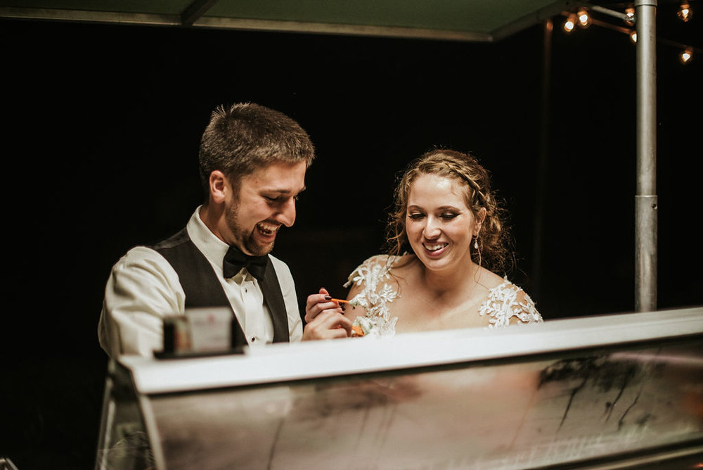 bride and groom eating gelato at Historic Rosemont Manor