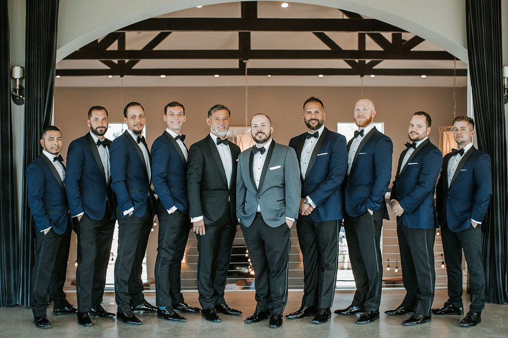 Groom and his Groomsmen posing at Blue Valley Vineyard