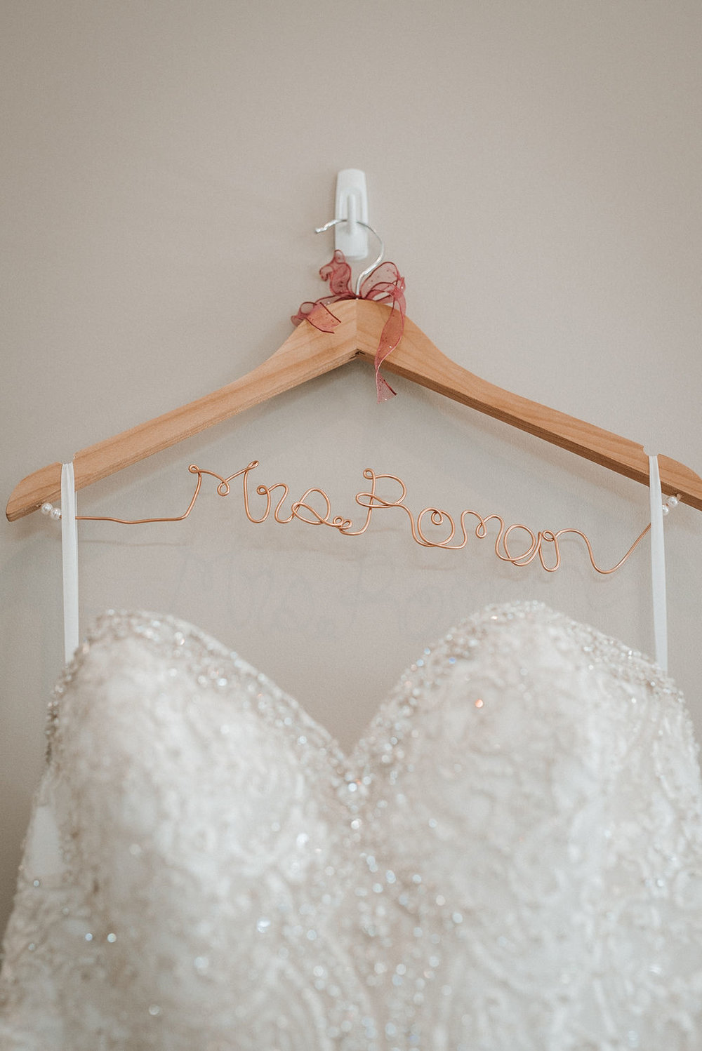 Detail Shot of Bride's Wedding Hanger and Wedding Dress at Blue Valley Vineyard