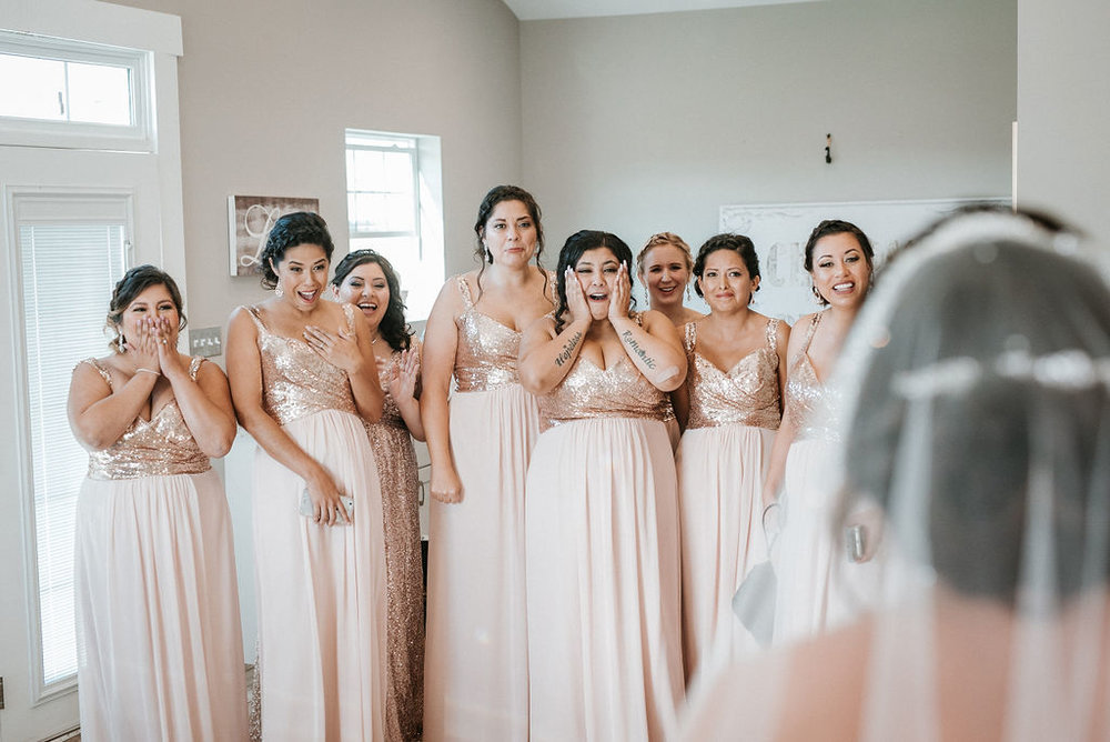 Bride does a first look with her bridesmaids at Blue Valley Vineyard