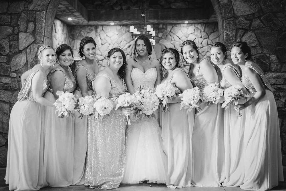 Bride and her bridesmaids posing at Blue Valley Vineyard