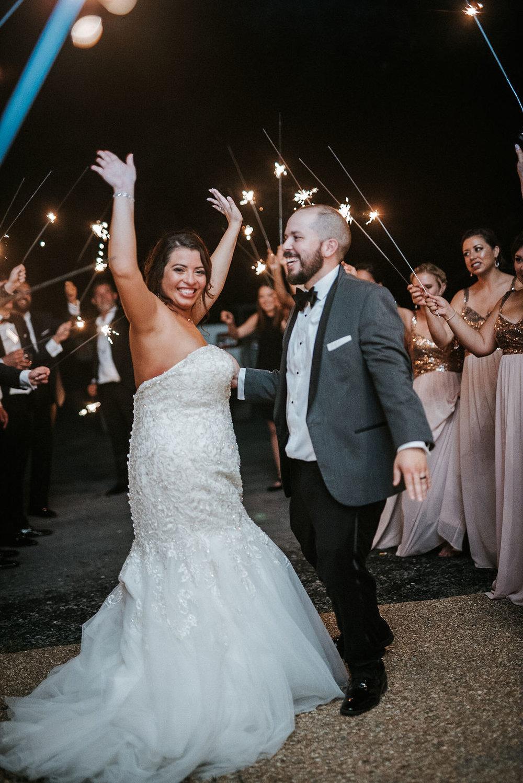 bride and groom smiling under sparklers at Blue Valley Vineyard