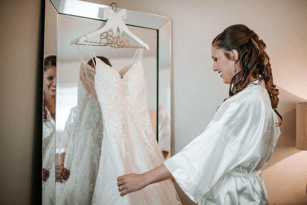 Bride admiring her wedding dress at 48 Fields Farm