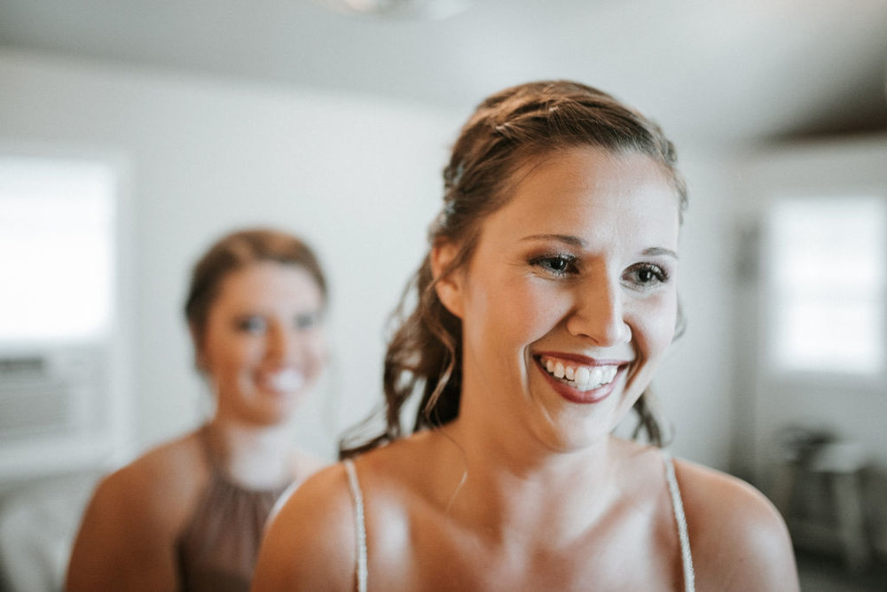 Bride smiling as she gets ready at 48 Fields Farm