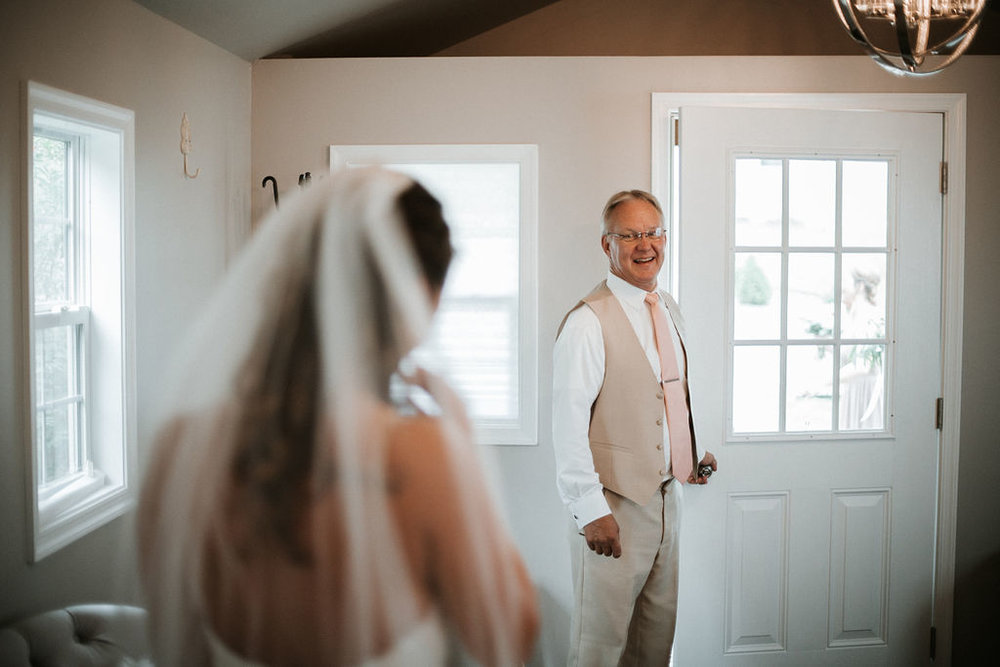 bride and father of the bride doing a first look at 48 Fields Farm