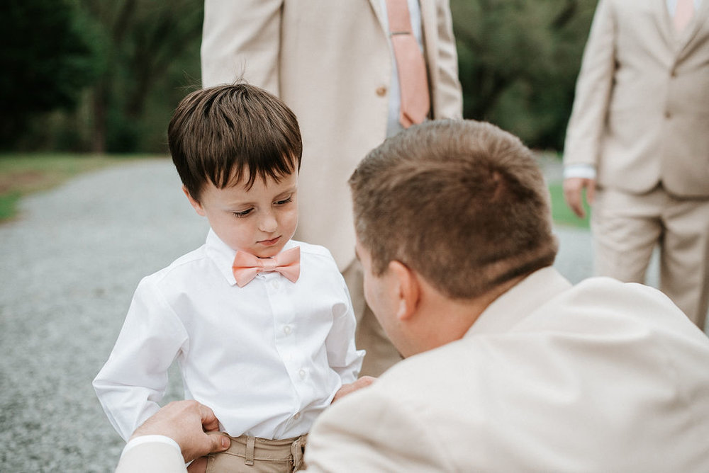 Groom getting ready with ring bearer at 48 Fields Farm