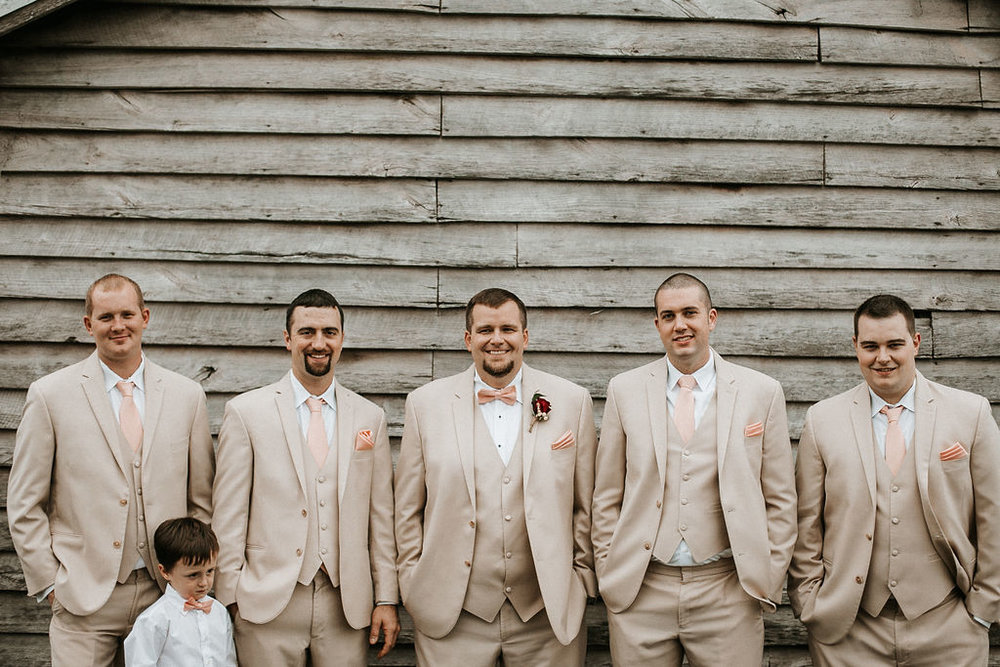 Groom and Groomsmen smiling at 48 Fields Farm