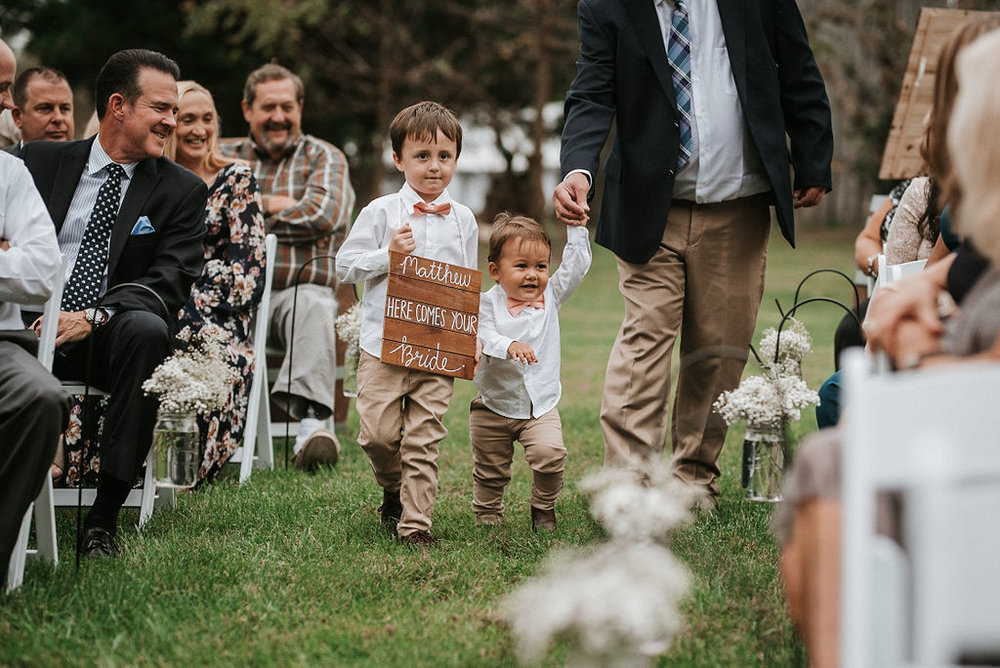 Ring Bearer's walking up the aisle at 48 Fields Farm