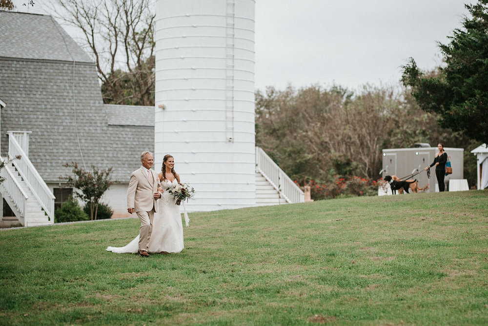 Bride and Father of The bride walking up the aisle at 48 Fields Farm